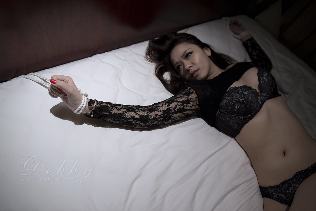 bed to girl Asian tied