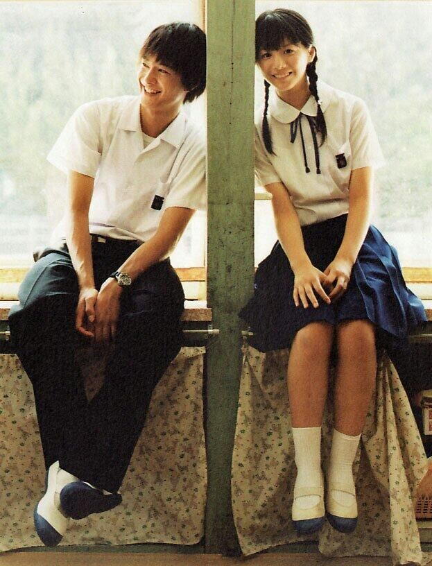 uniform otngagged Asian couple